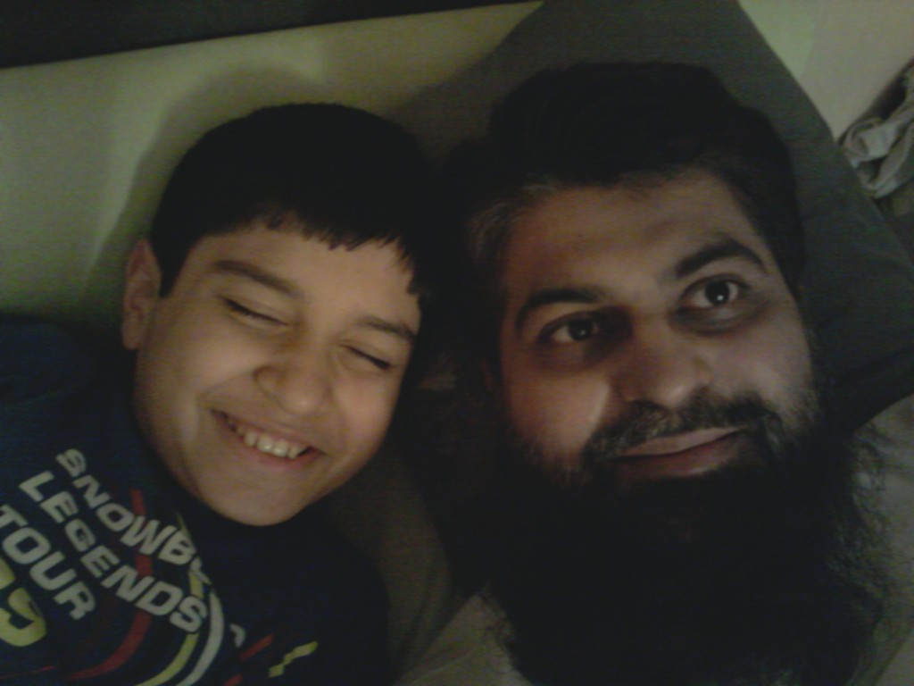Humza, now age 11, with his 'superhero' dad, Amir